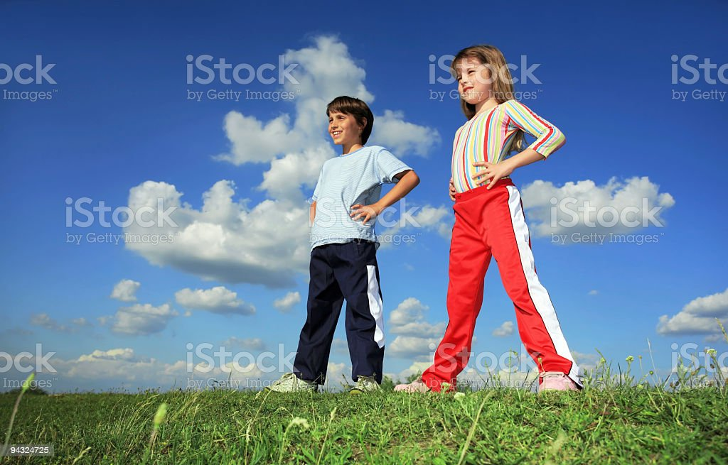 Kids on meadow stock photo