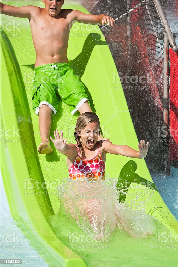 Kids on slide at water park stock photo