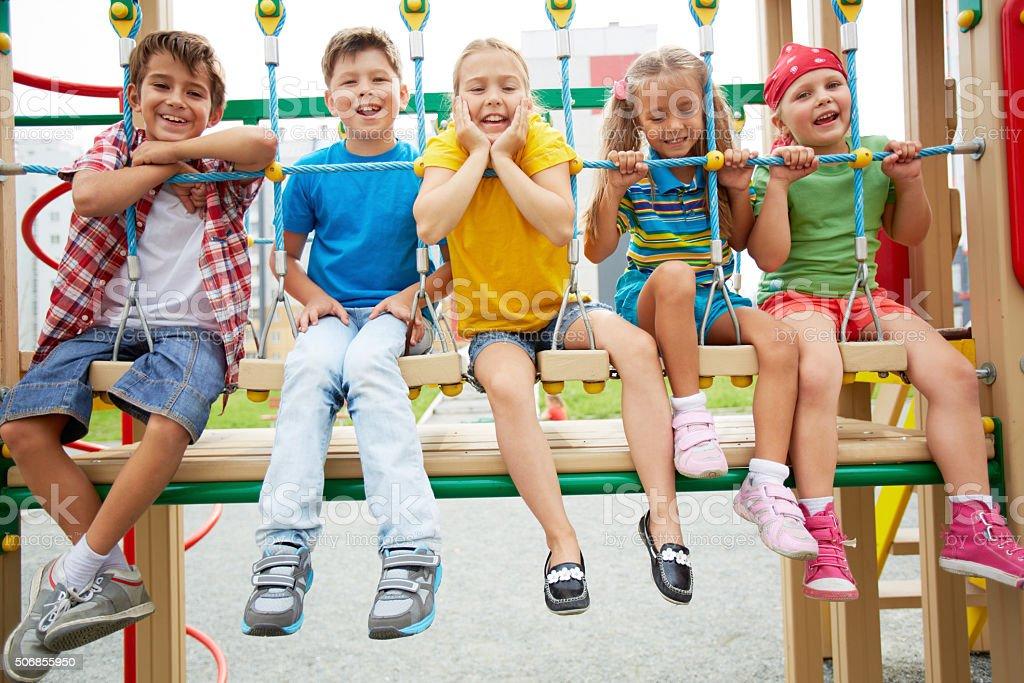 Kids on swing stock photo
