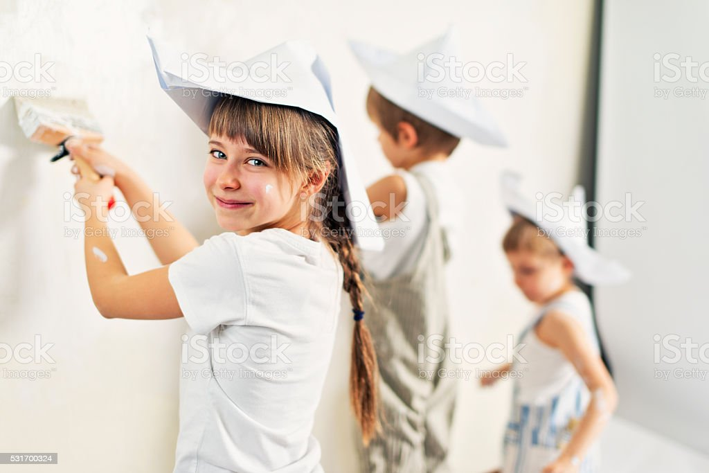 Kids painting their room white stock photo