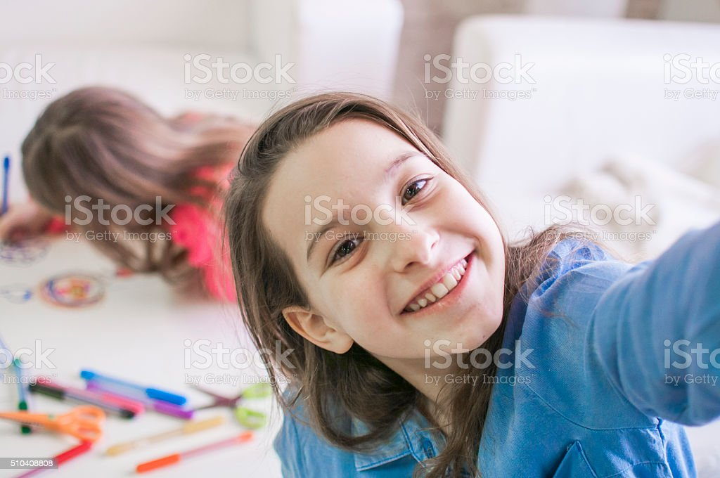 Kids photographing while playing stock photo