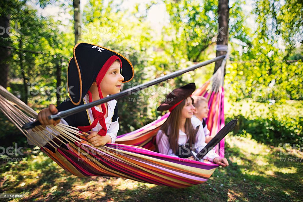 Kids pirates playing on hammock boat stock photo