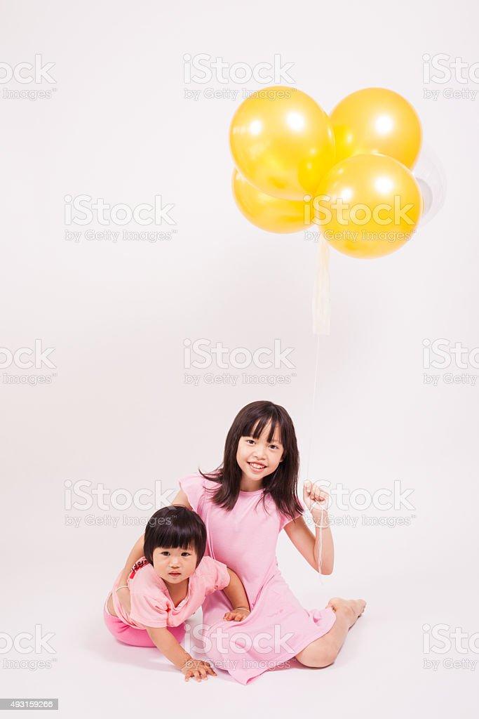kids play balloons stock photo