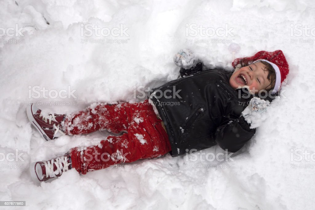 Kids play in snow during Christmas vacation stock photo