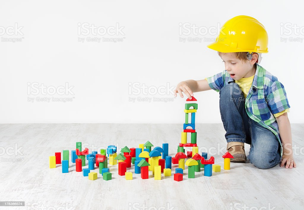 Kids Play Room, Child Hard Hat Playing Building Blocks Toys stock photo