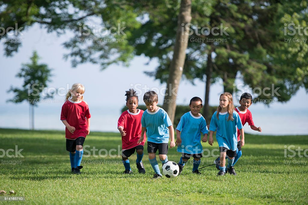 Kids Playing a Soccer Game stock photo