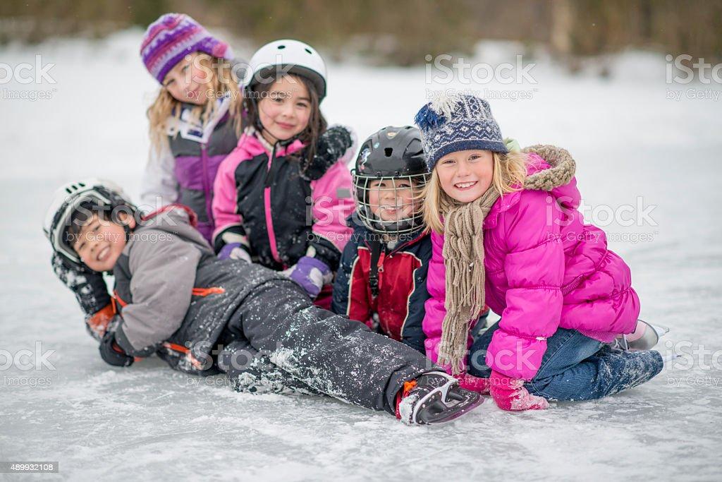 Kids Playing Around While Ice Skating stock photo
