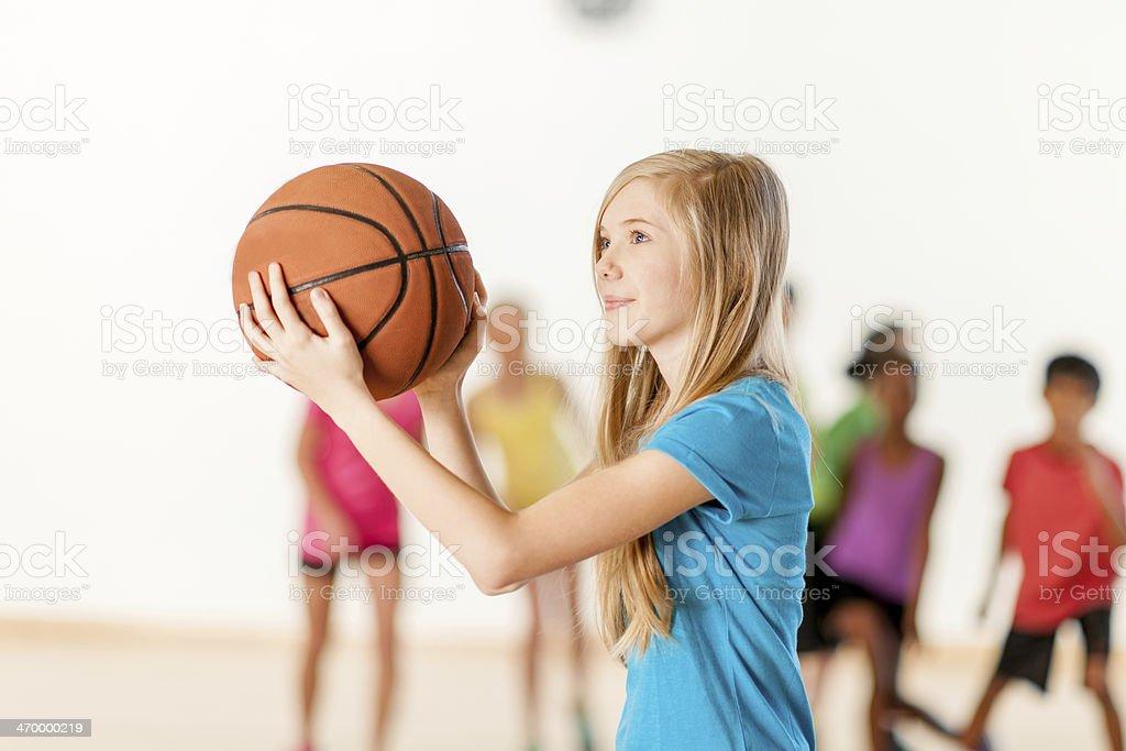 Kids playing basketball royalty-free stock photo