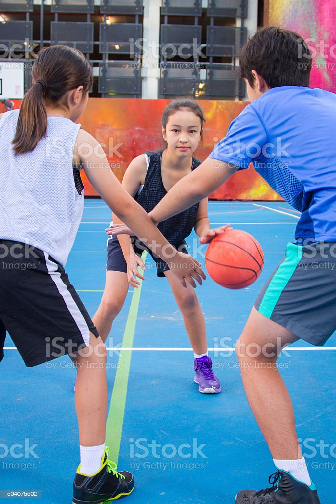 Kids Playing Basketball stock photo