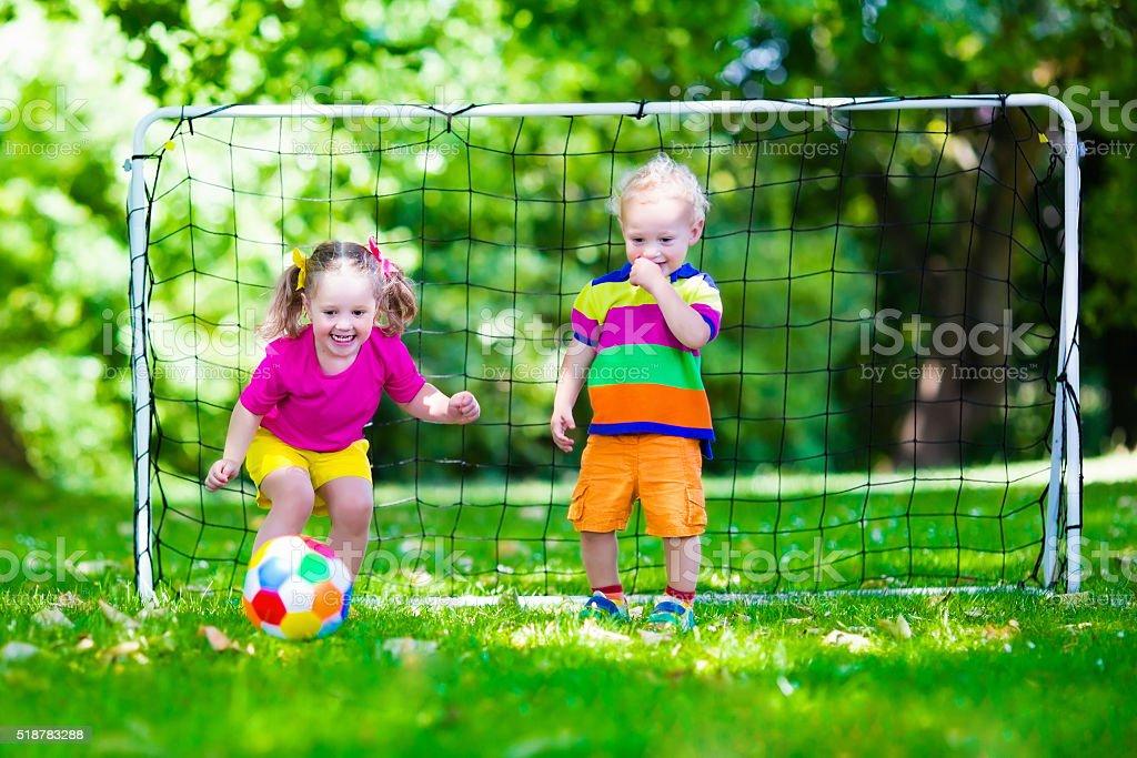 Kids playing football in school yard stock photo