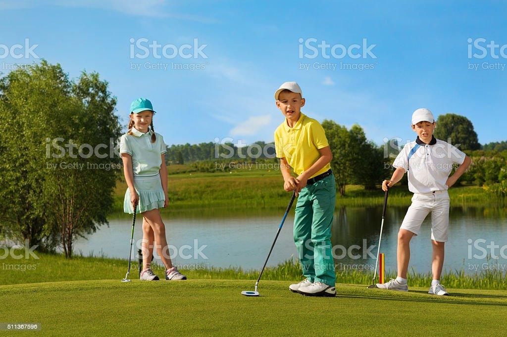 Kids playing golf stock photo