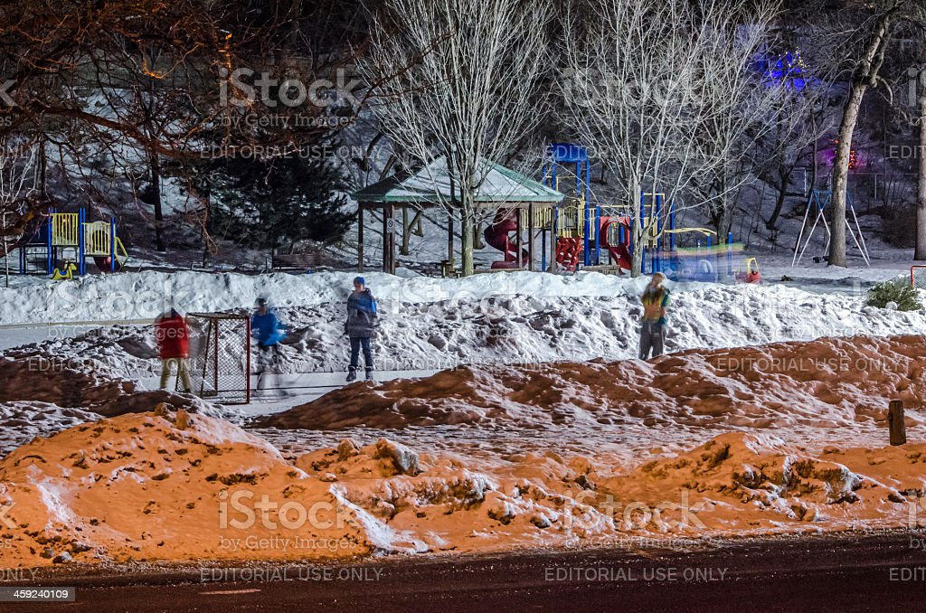 Kids Playing Hockey on Outdoor Rink stock photo