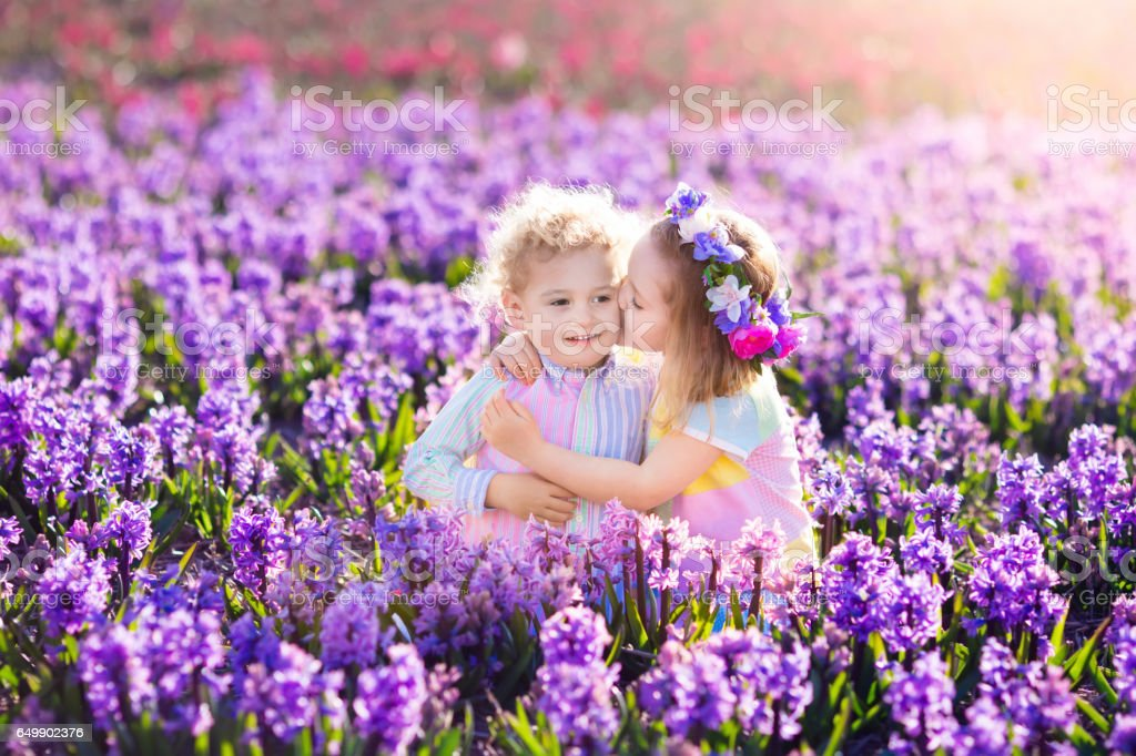 Kids playing in blooming garden with hyacinth flowers royalty-free stock photo