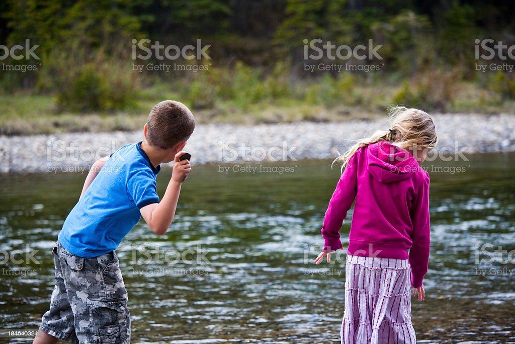Kids playing in creek royalty-free stock photo