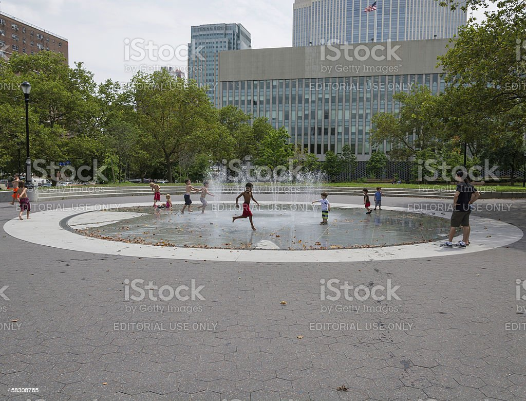 Kids playing in fountain on a hot summer day royalty-free stock photo