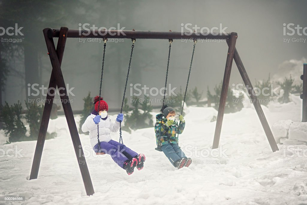Kids playing in garder in polluted air stock photo