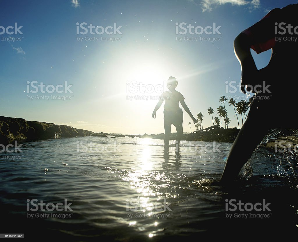 kids playing in natural pool outdoors royalty-free stock photo