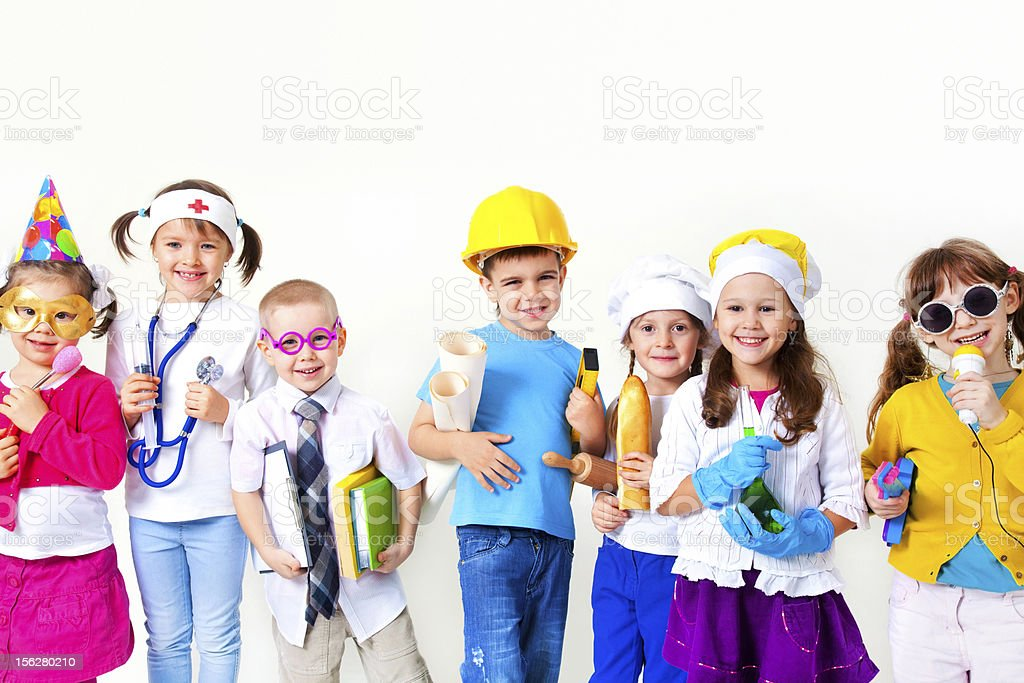 Kids playing in professions stock photo