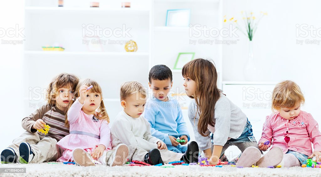 Kids playing in the living room. royalty-free stock photo