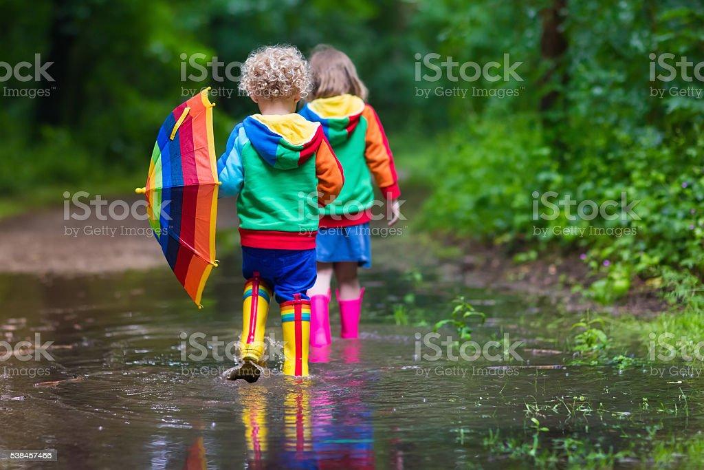 Kids playing in the rain stock photo