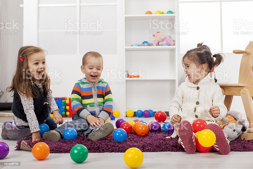 Kids playing in the room stock photo