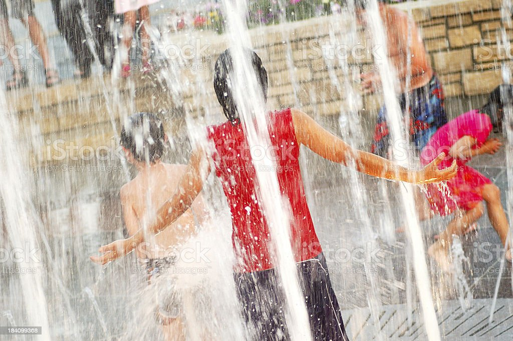 Kids Playing in Water Fountains royalty-free stock photo