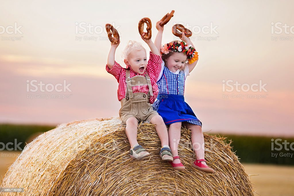 Kids playing in wheat field in Germany stock photo