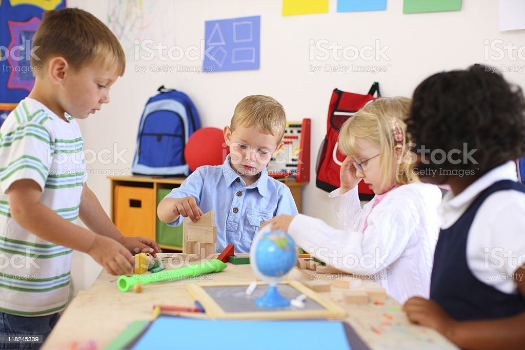 Kids playing inside a preschool classroom royalty-free stock photo