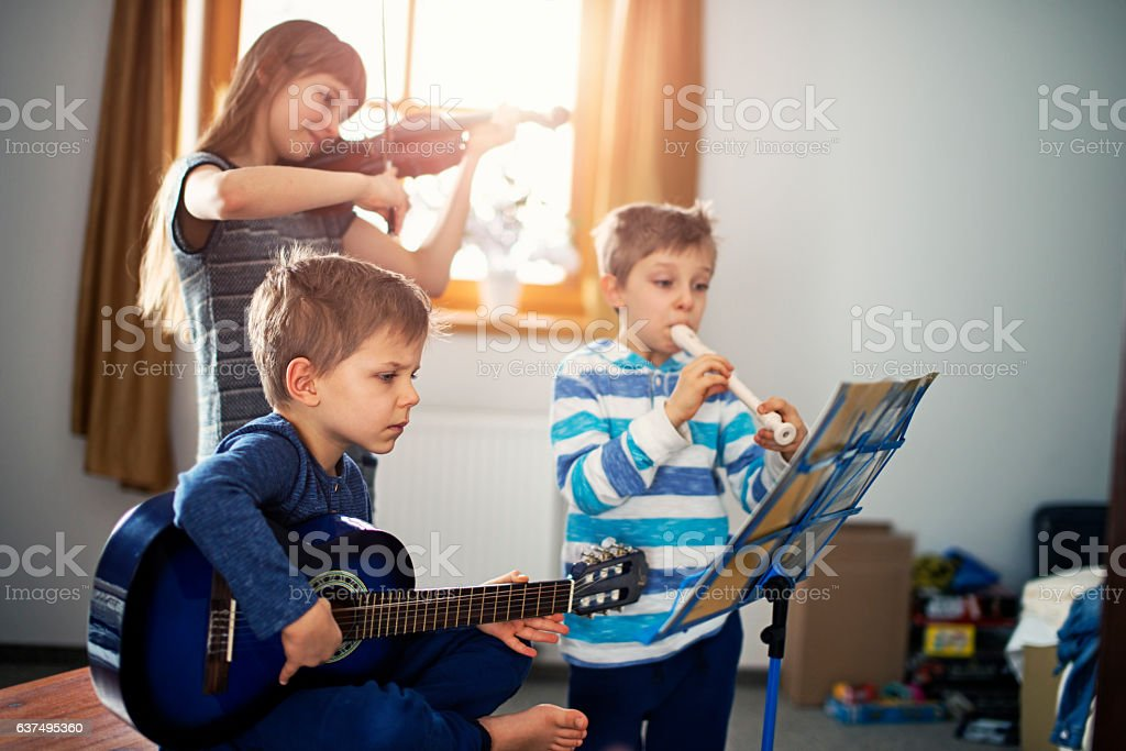 Kids playing music together stock photo