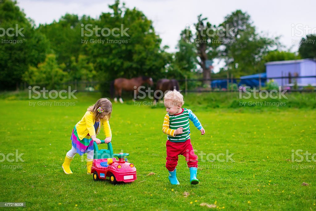 Kids playing on a farm stock photo