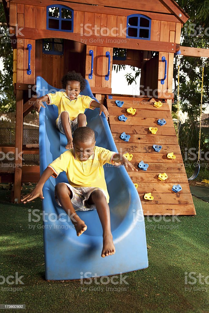 Kids Playing On Slide royalty-free stock photo