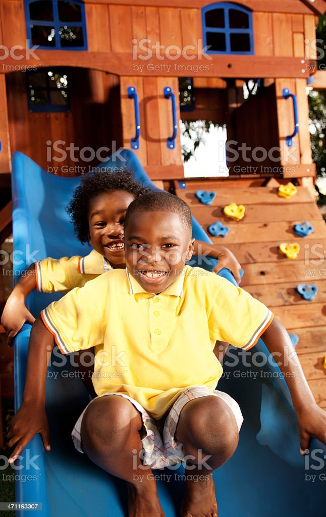Kids Playing On Slide royalty-free stock photo
