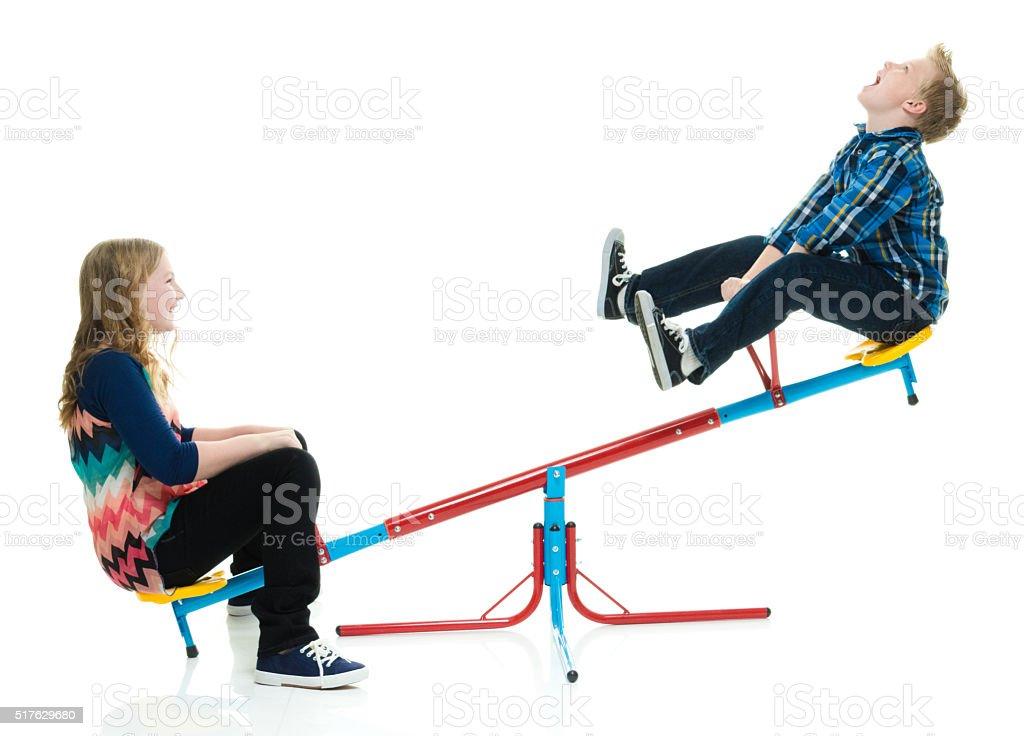 Kids playing on teeter totter stock photo