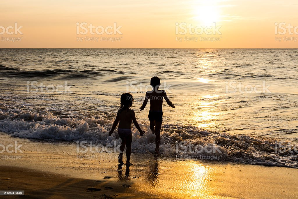 Kids playing on the beach. Exotic, tropical destinations. stock photo