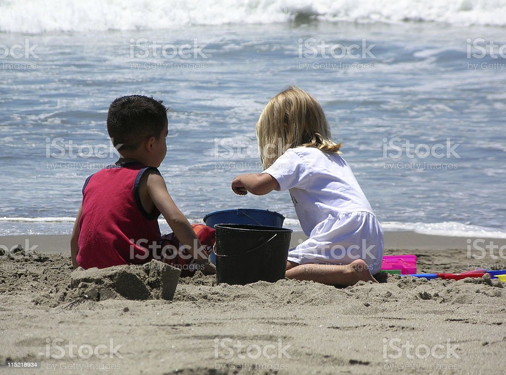 Kids playing on the beach royalty-free stock photo