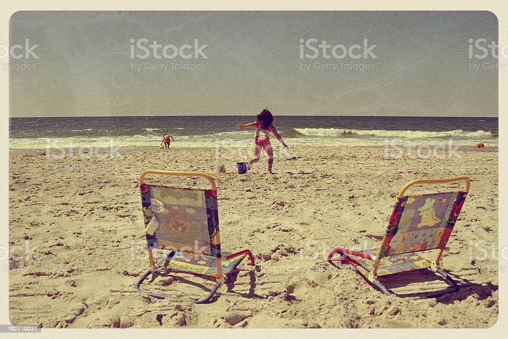 Kids Playing on the Beach - Vintage Postcard stock photo