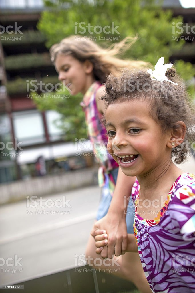 Kids playing outdoors royalty-free stock photo