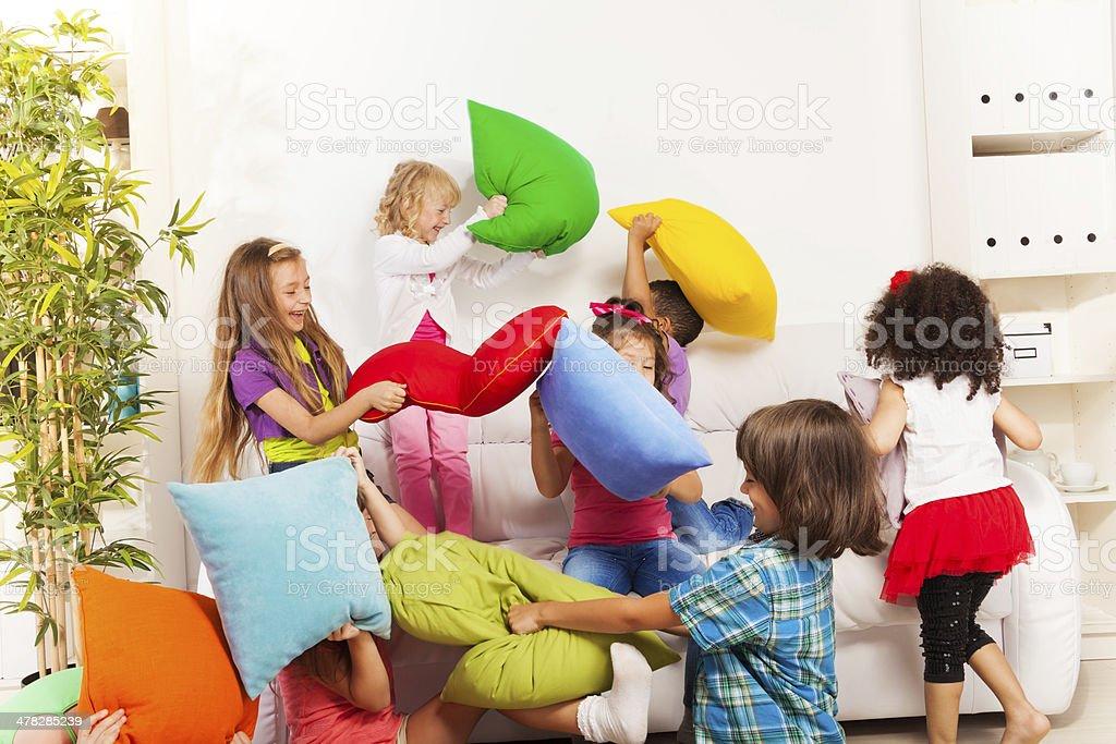 Kids playing pillow fight stock photo