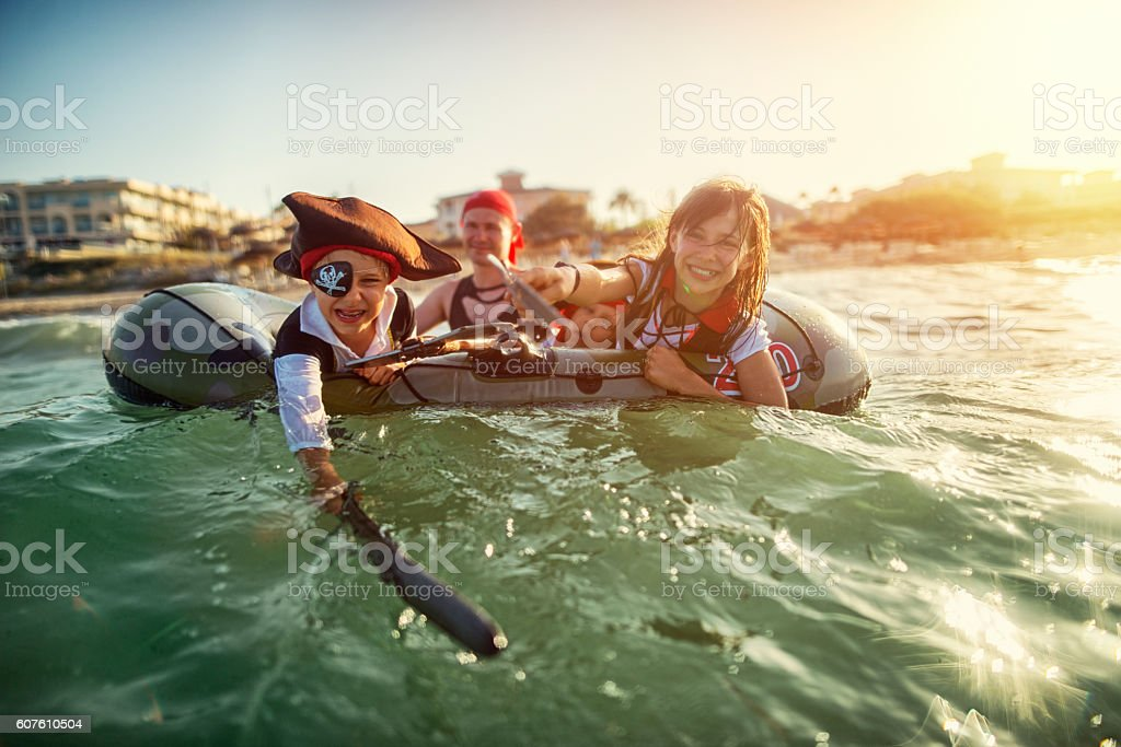 Kids playing pirates at sea on a boat stock photo