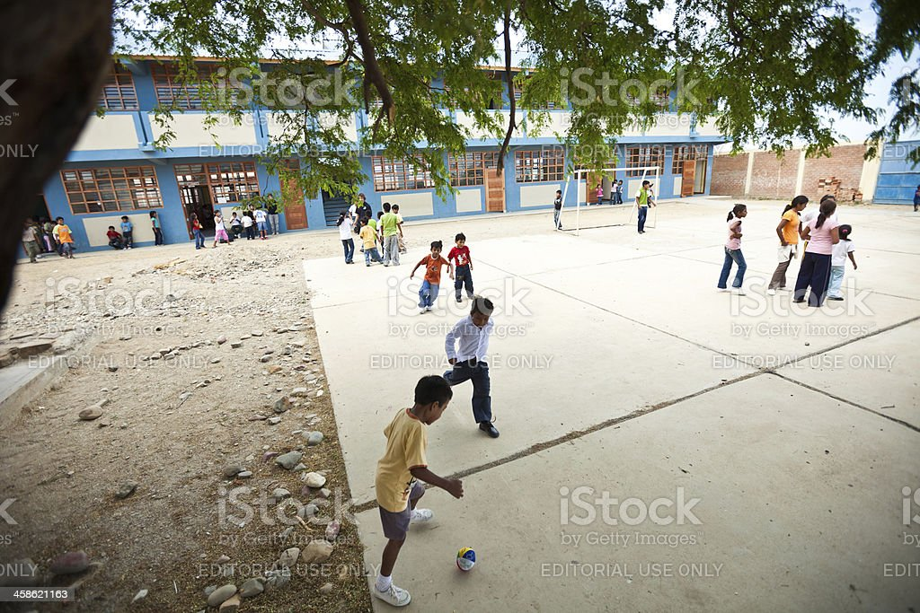 Kids playing soccer at an elementary school in Peru stock photo