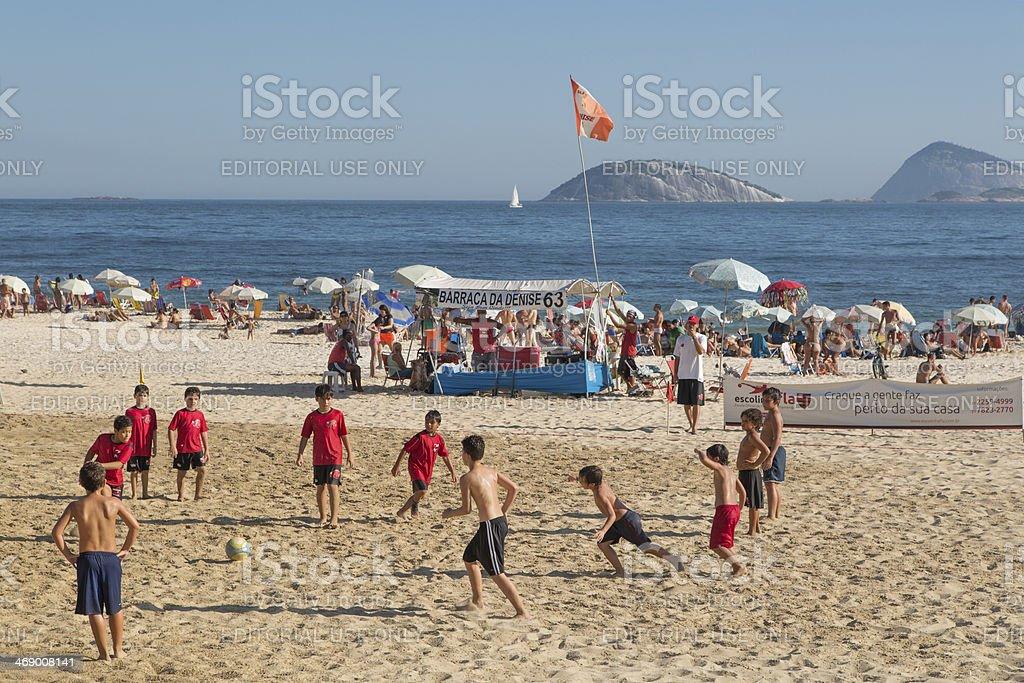 Kids playing soccer in Ipanema Beach royalty-free stock photo