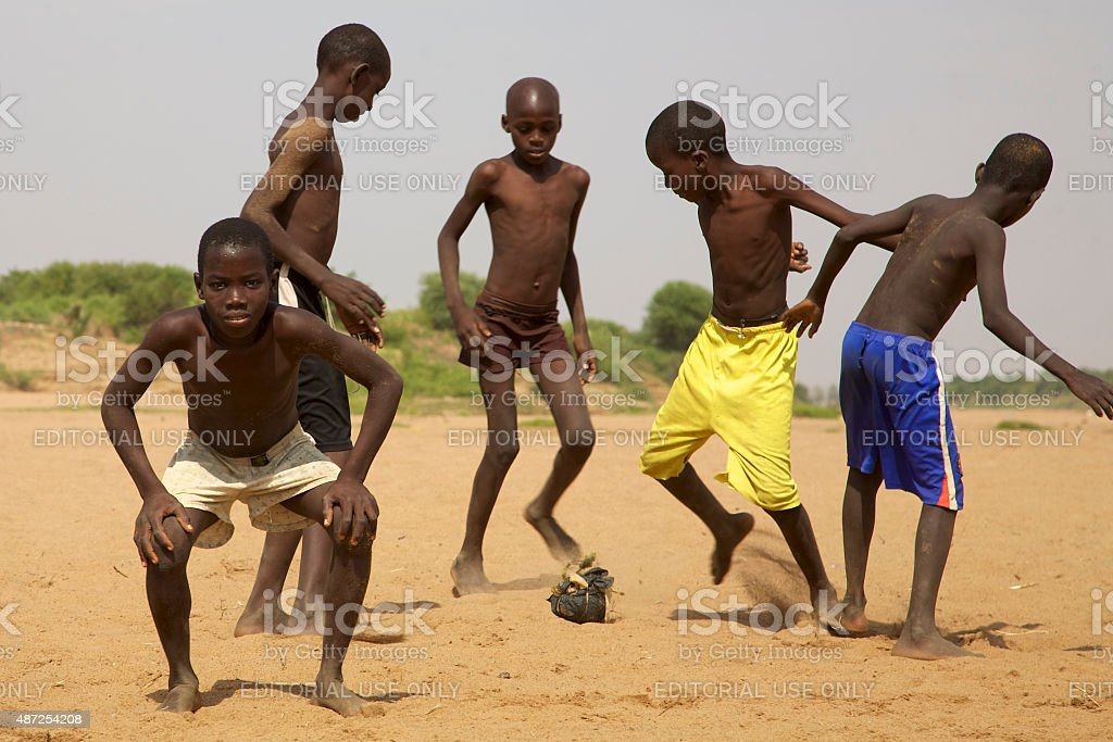 Kids playing soccer in Saint Louis stock photo