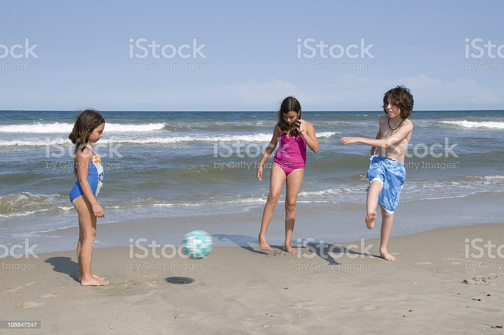 Kids Playing Soccer on the Beach royalty-free stock photo