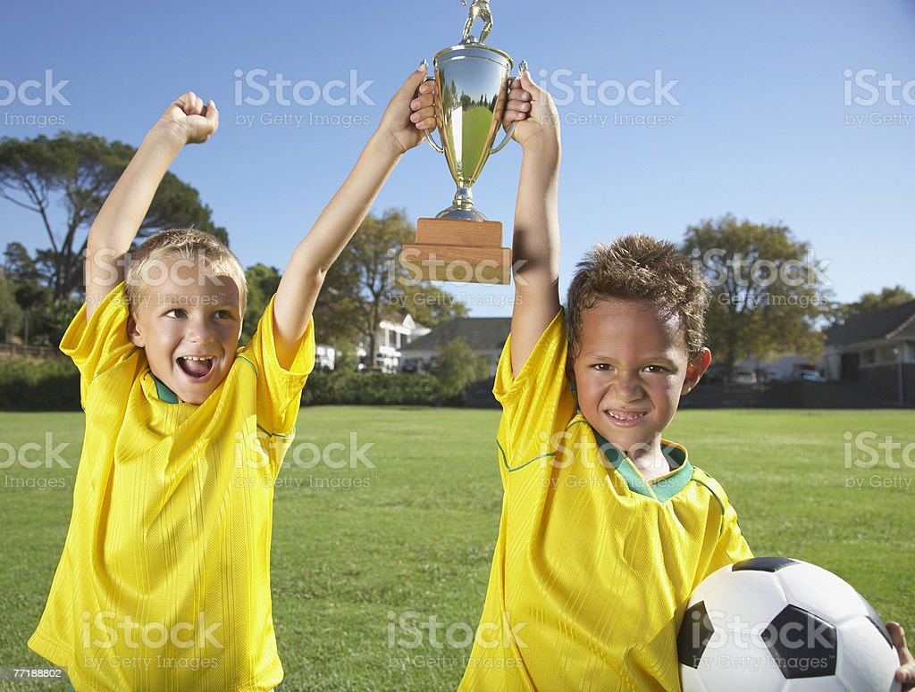 Kids playing soccer stock photo
