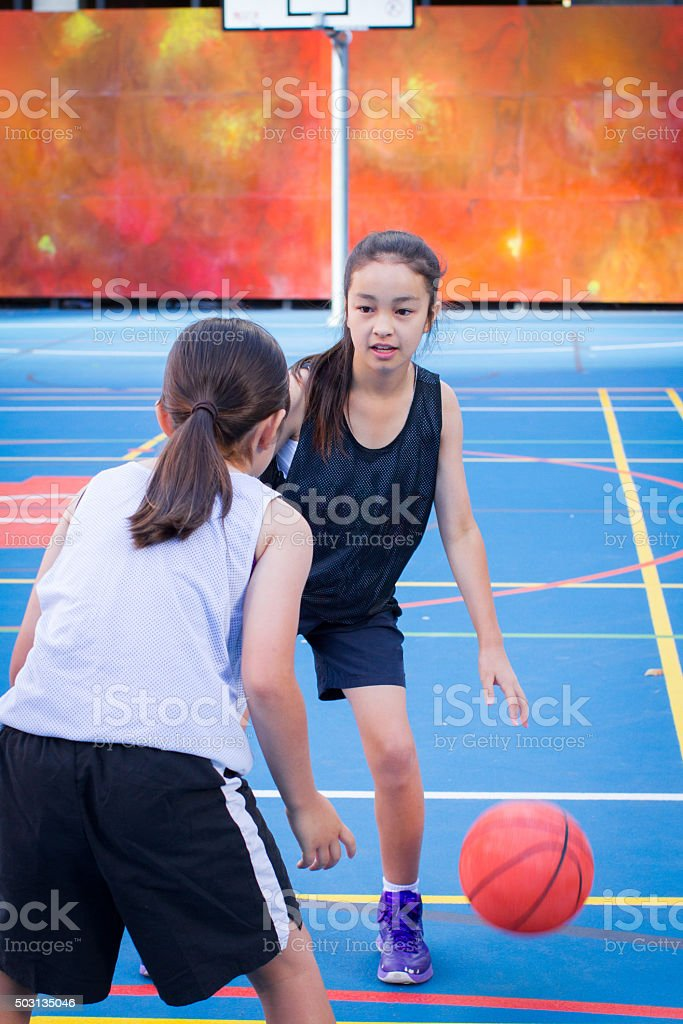 Kids Playing Street Basketball stock photo