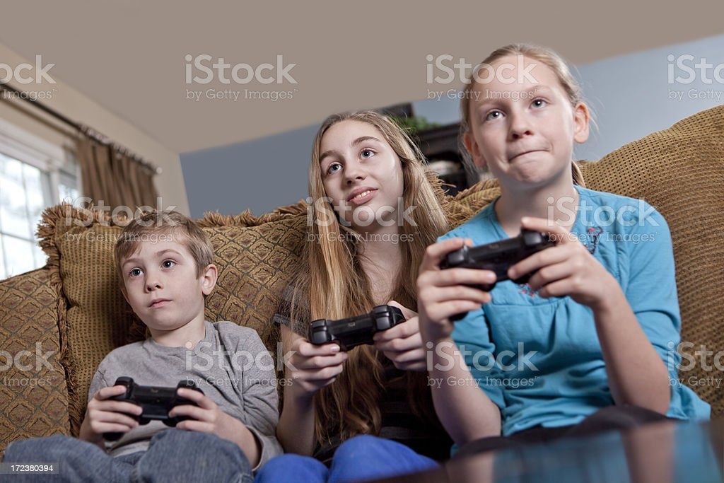 Kids Playing Video Games royalty-free stock photo