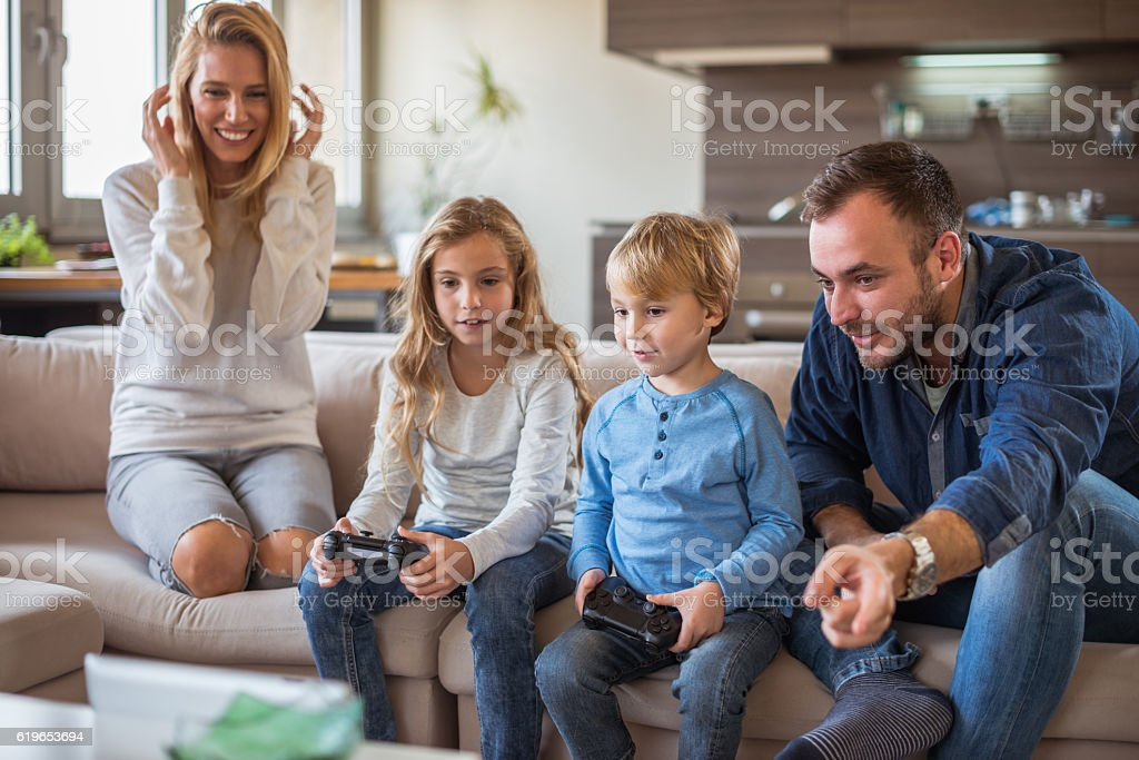 Kids playing video games stock photo