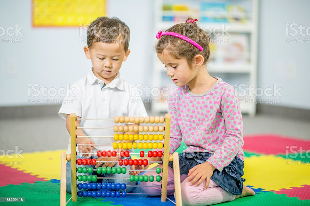Kids Playing with an Abacus at School stock photo