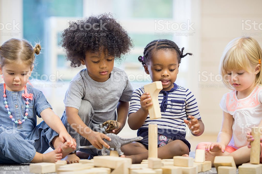 Kids Playing with Building Blocks stock photo