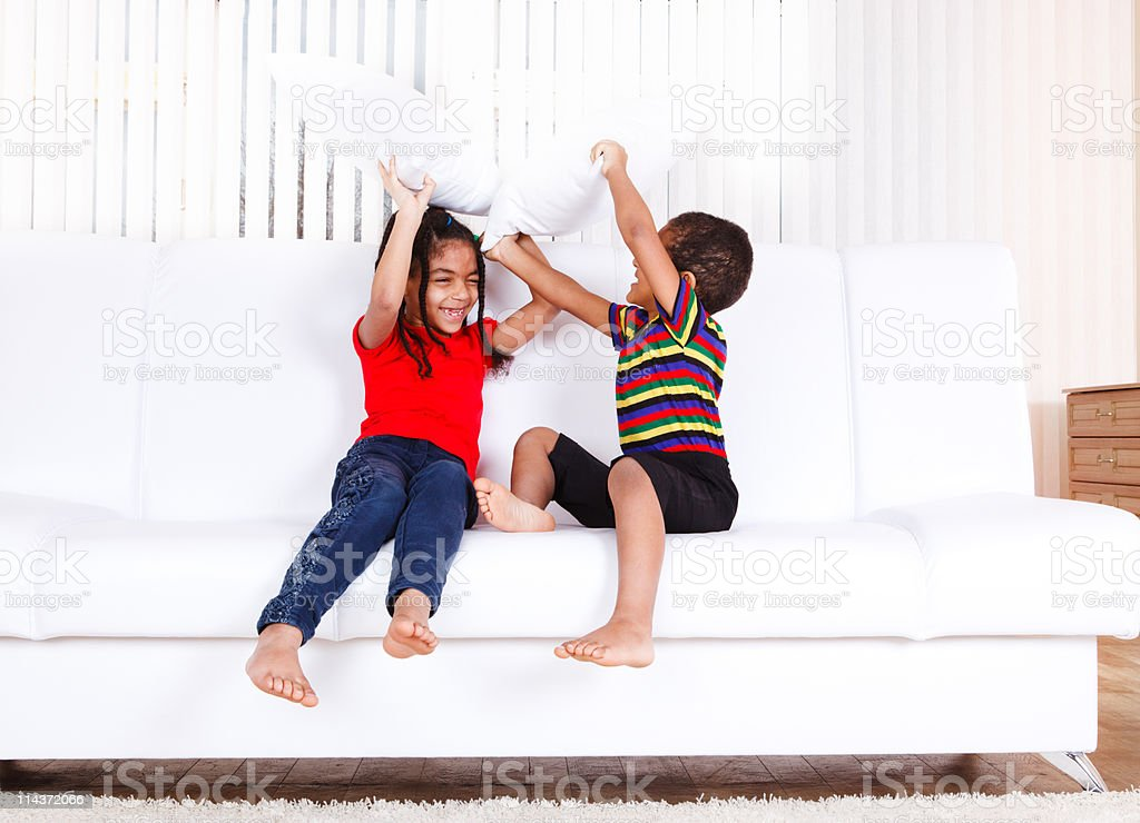 Kids playing with pillows royalty-free stock photo